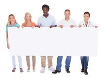 Casual group of people with placard Stock Images