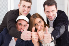 Casual group of successful people make the ok thumbs up sign Royalty Free Stock Photography