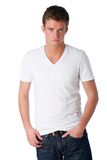 Casual guy. Young man poses wearing white t-shirt and jeans Royalty Free Stock Photo