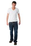 Casual guy. Young man poses wearing white t-shirt and jeans Royalty Free Stock Photos