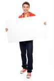 Casual guy with blank placard Stock Image
