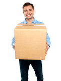 Casual guy carrying packed cardboard boxes Stock Photos