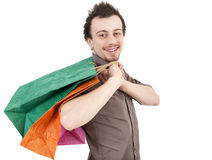 Casual guy with coloured shopping bags Stock Photography