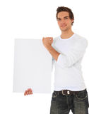 Casual guy holding blank white sign Stock Photo