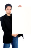 Casual guy holding board Stock Images