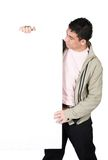 Casual guy holding a white board Stock Photo