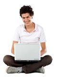 Casual guy on a laptop Stock Photography