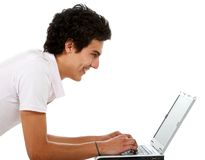 Casual guy on a laptop Royalty Free Stock Photography