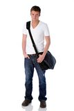 Casual guy with laptop bag. Young man poses with laptop bag over his shoulder Stock Image