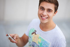 Casual guy with mobile phone Stock Image