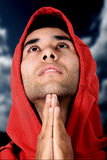 Casual guy praying Royalty Free Stock Photos