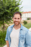 Casual guy relaxed in a park Stock Photography