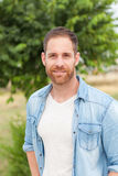 Casual guy relaxed in a park Royalty Free Stock Image