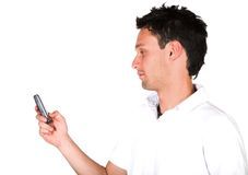 Casual guy sending an sms Stock Image