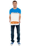Casual guy showing freshly baked yummy pizza Royalty Free Stock Photo