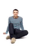 Casual guy sitting Royalty Free Stock Photos