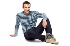 Casual guy sitting Stock Images