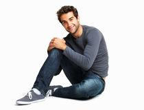 Casual guy sitting on floor Stock Photo