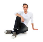 Casual guy sitting on the floor Royalty Free Stock Photo