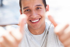 Casual guy with thumbs up Stock Images