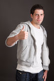 Casual guy thumbs up - success Stock Photos