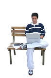 Casual guy using laptop Royalty Free Stock Photos