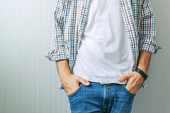 Casual handsome man wearing jeans and plaid shirt Royalty Free Stock Photography