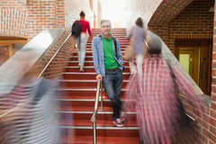 Casual handsome student standing on stairs Stock Photography