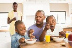Casual happy family having breakfast stock photo