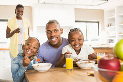 Casual happy family having breakfast stock photography