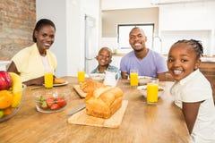 Casual happy family having breakfast royalty free stock photos