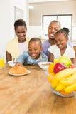 Casual happy family having breakfast stock image