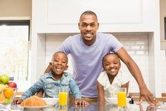 Casual happy family having breakfast royalty free stock photo