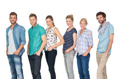 Casual happy people standing with hands in pockets Royalty Free Stock Image