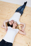 Casual happy young couple relax on their backs Royalty Free Stock Image