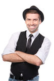 Casual happy young man standing with his arm crossed. Royalty Free Stock Images