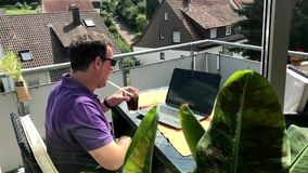 Casual homeoffice on the balcony stock video footage