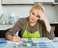 Casual housewife filling payments bills Stock Photo