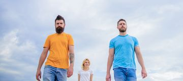 Casual inspired. Fashion people look casual in summer outfit. Pretty woman and men friends walking outdoor. Group of. Casual inspired. Fashion people look casual royalty free stock photography