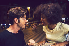 Casual interracial couple having an argument in a terrace Royalty Free Stock Images