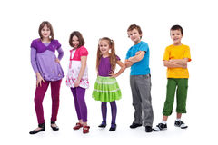 Casual kids in a row. Smiling and posing - isolated Royalty Free Stock Photo
