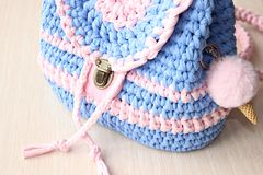 Casual knitted backpack in delicate colors. stock photo