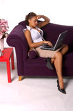 Casual LAptop. Beautiful woman on the couch with a laptop computer Stock Photo