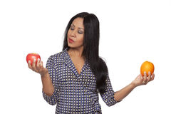 Casual Latina - apple versus orange stock photography