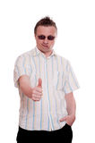 Casual looking man is holding his thumb up Stock Image