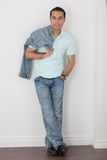 Casual Male in Jeans and Golf Shirt Stock Photography