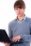 Casual male with a laptop Royalty Free Stock Images