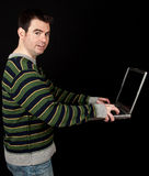 Casual male on laptop with black screen drop Stock Image