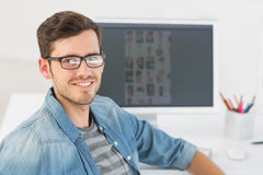 Casual male photo editor in front of computer royalty free stock image