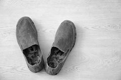Casual male shoes. On wooden floor Royalty Free Stock Images
